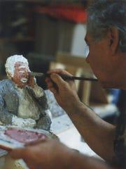 Adolph Rosenblatt paints a sculpture of former Journal Sentinel art critic James Auer.