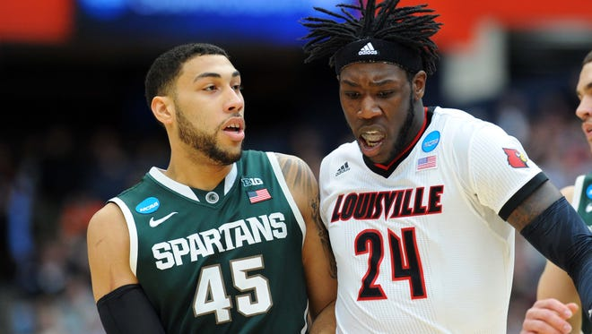 Louisville Cardinals forward Montrezl Harrell (24) runs into Michigan State Spartans guard Denzel Valentine (45) during the first half in the finals of the east regional of the 2015 NCAA Tournament at Carrier Dome.