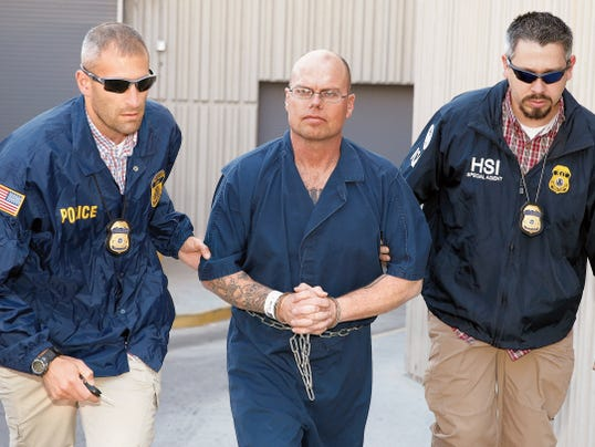 Army Sgt. 1st Class Michael Hall, who is stationed at Fort Bliss, is escorted from the El Paso County Detention Facility by Immigration and Customs Enforcement Homeland Security Investigations agents Thursday morning.