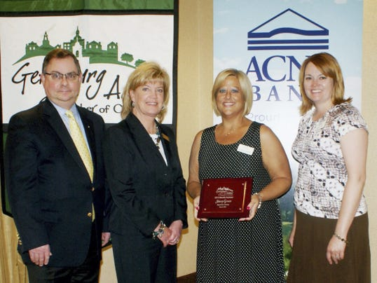 Minority Owned Business: Stacey Green, owner of Biggerstaff's Catering in Gettysburg, was honored with the 2015 Minority Business award by the Gettysburg Adams Chamber of Commerce recently as part of Business Development Week and National Small Business Week. From left, are ACNB Bank Vice President and Senior Commercial Loan Officer George Marguglio, ACNB Bank Vice President and Treasury Management Manager Cheryl McVay, Green and Gettysburg Adams Chamber of Commerce President Carrie Stuart.