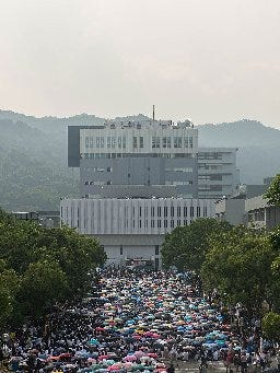 Thousands of students rally at Chinese University of Hong Kong on Monday, Sept. 22, 2014, in Hong Kong.  Students demanded the resignation of some top city officials and for citizens to be allowed to nominate their own candidates for an election.