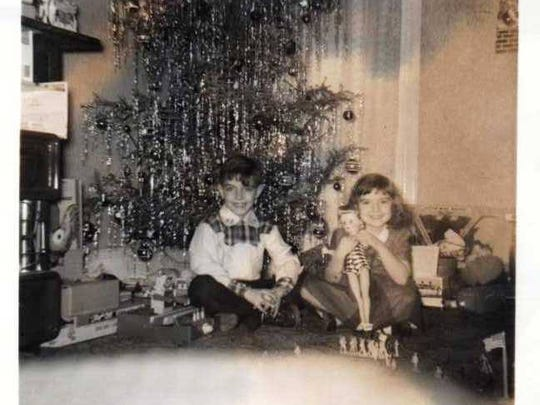 Cathy Magner and her brother Bill opening their gifts in 1956.