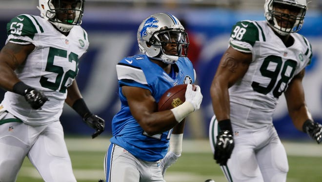 Lions running back Ameer Abdullah running away from the New York Jets for a long first down in the first quarter of the Lions' 23-3 exhibition win Thursday at Ford Field.