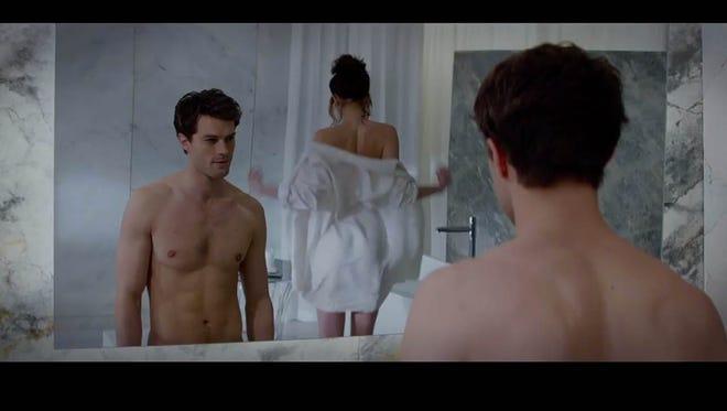 "Christian Grey (Jamie Dornan) and Anastasia Steele (Dakota Johnson) star in ""Fifty Shades of Grey."""