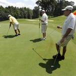 Golfers from left, Johnny Dollar, Cutis Estes, Bill Morgan and Kip Dollar play at the Robert Trent Jones Golf Trail on Capitol Hill in Prattville on Wednesday. MONEYmagazine has named Prattville as the best place in the country for golfers to retire.