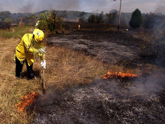 Brentwood fireman Allen Wessels smothers flames with