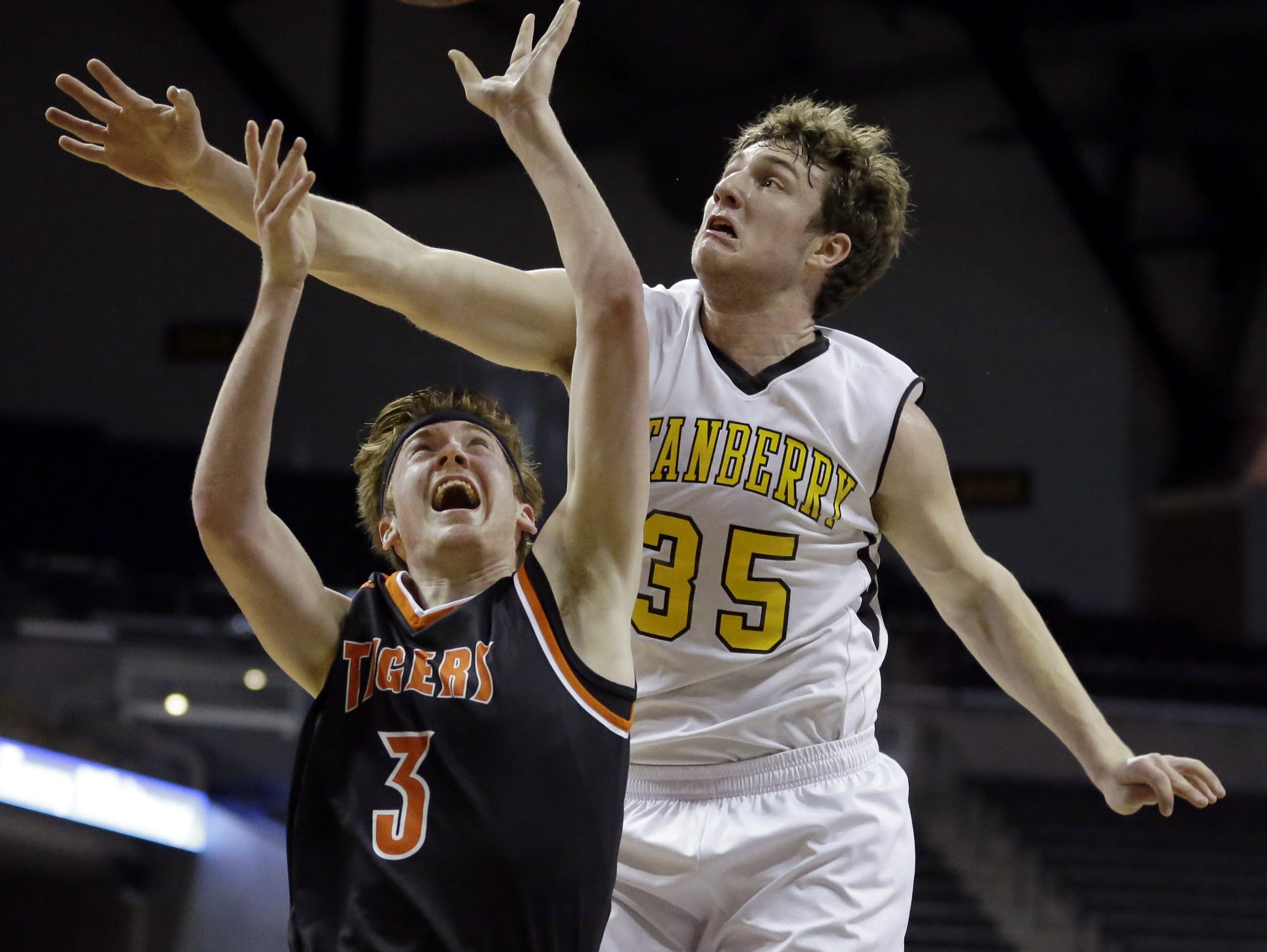 Dallas Meinders (3) of Walnut Grove shoots as Daniel Hailey of Stanberry defends during the Class 1 boys championship game.