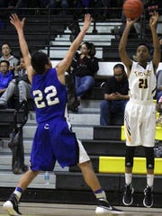 Alamogordo's Bishup Woodruff attempts a three-pointer