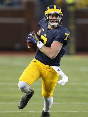 Michigan QB Shane Morris runs for a first down during the second half of U-M's spring game at Michigan Stadium.