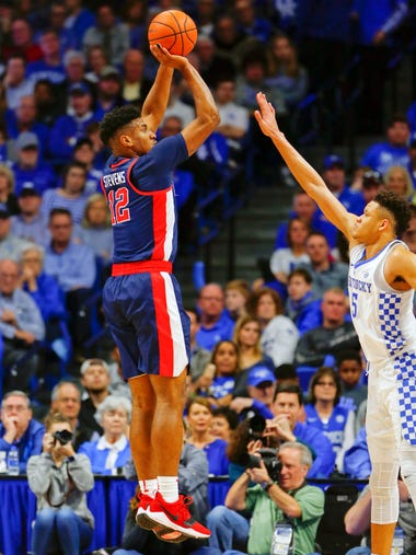 Ole Miss forward Bruce Stevens (12) shoots the ball