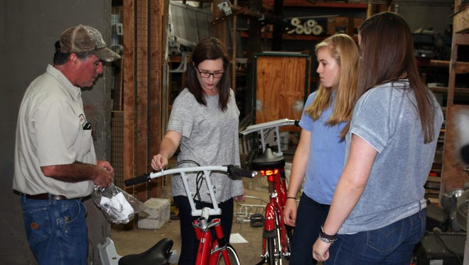 City Parks & Recreation staff and Clarksville Academy students worked Friday to assemble new BCycles for two new stations for the city's bike-sharing program.