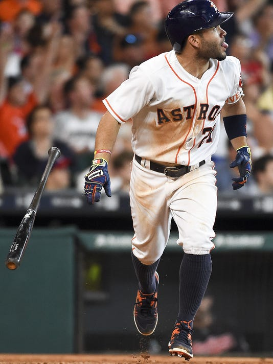 Houston Astros' Jose Altuve watches his double in the sixth inning of a baseball game against the Cleveland Indians, Wednesday, May 11, 2016, in Houston. (AP Photo/Eric Christian Smith)