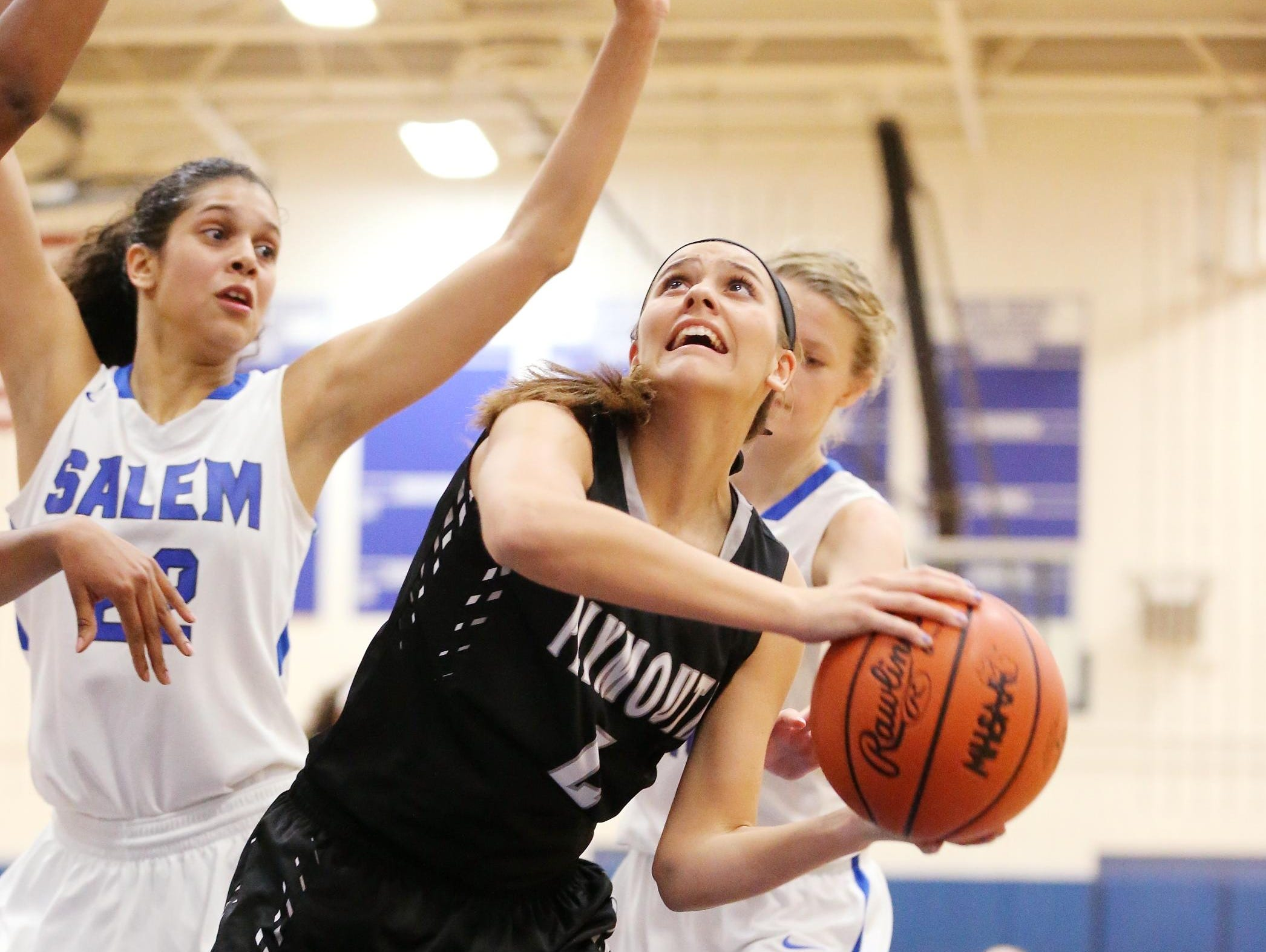 Going up for a shot Tuesday is Plymouth junior Mikayla Rose (No. 4). At left for Salem is Lasha Petree (No. 22).
