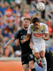 FC Cincinnati midfielder Richie Ryan (16) and North