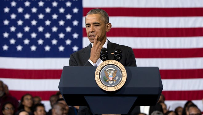President Obama pauses as he speaks during a town hall at McKinley Senior High School in Baton Rouge, La., Thursday