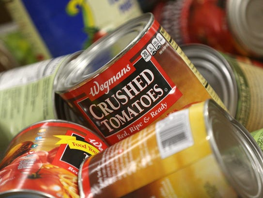 Some of the cans of food that arrives regularly from