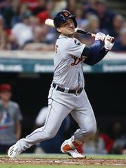 Tigers shortstop Jose Iglesias hits an RBI single against
