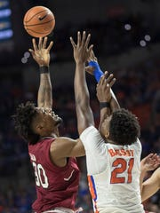 South Carolina forward Chris Silva (30) shoots over Florida forward Dontay Bassett (21) during the first half of an NCAA college basketball game in Gainesville, Fla., Wednesday, Jan. 24, 2018. (AP Photo/Ron Irby)