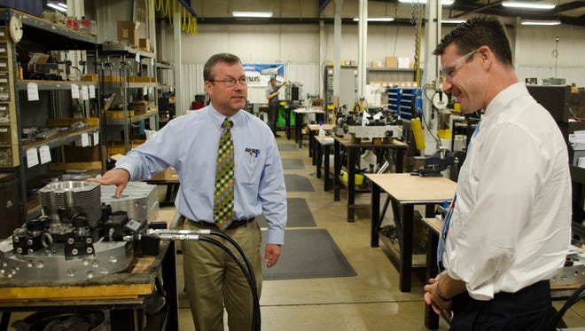 Ahaus Tool & Engineering president Kevin Ahaus shows U.S. congressional representative and U.S. Senate candidate Todd Young (R-IN 9th District) around Ahaus Tool and Engineering in Richmond on Tuesday, Sept. 6, 2016.