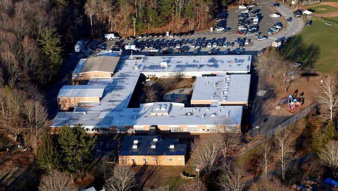 Aerial file photo shows Sandy Hook Elementary School in Newtown, Conn., where a gunman shot 27 people dead, including 20 children.