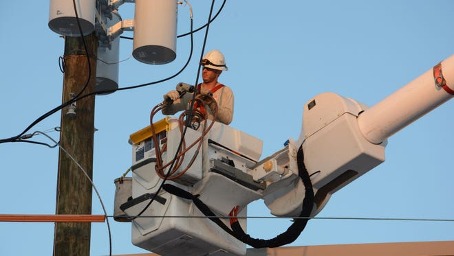 A Gulf Power lineman performs work in the downtown Pensacola area. A bill by Rep. Clay Ingram would give exclusive authority to the Public Service Commission on how energy infrastructure is installed.