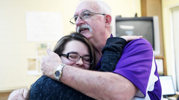 North Henderson student Lea Jones hugs Val Burch goodbye on his last day of teaching at North Henderson before retirement March 23, 2018.