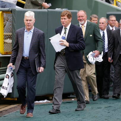 Green Bay Packers general manager Ted Thompson, left, and president Mark Murphy enter the Lambeau Field July 21, 2016 for the annual shareholders meeting.