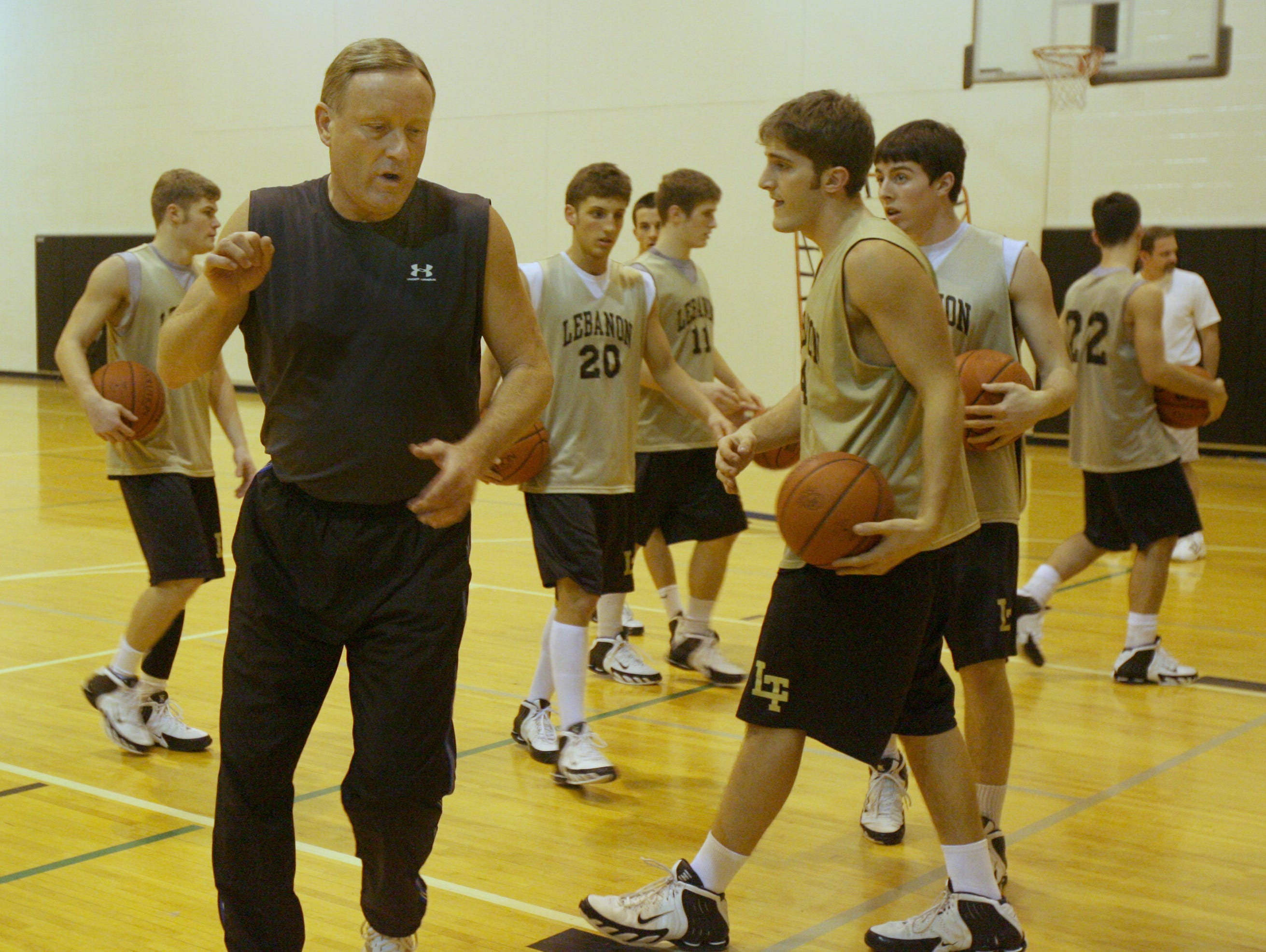 Rick Mount works with the Lebanon High School boys basketball team in 2006. His relationship with the Tigers nowadays is complicated.
