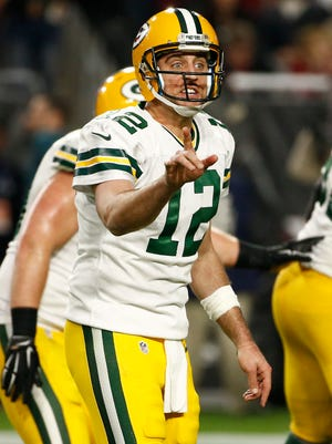 Green Bay Packers quarterback Aaron Rodgers prepares for a snap against the Arizona Cardinals on Dec. 27, 2015, in Glendale.