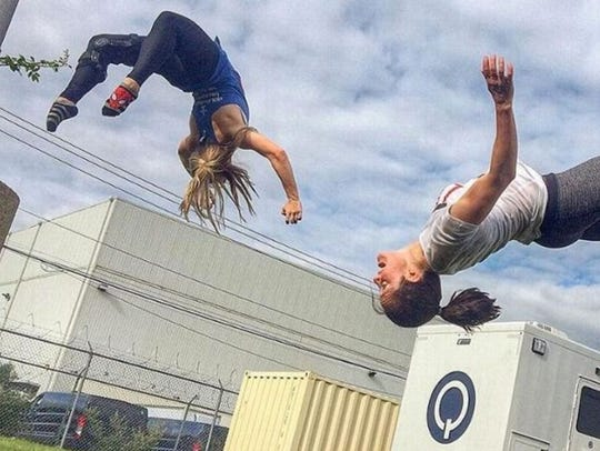 Meredith Richardson, left, gets in some stunt rehearsal