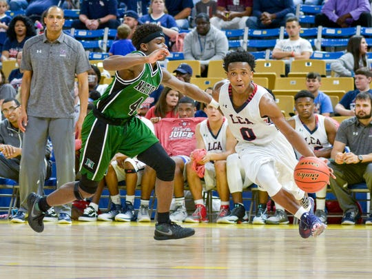 LCA guard Terrance Jones drives to the basket as Lafayette Christian takes on Hamilton Christian in the boys semi-final round of the state basketball championship in Burton Coliseum. 20170307-20170307.  Tuesday, March 7, 2017.