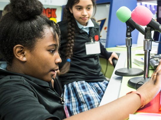 December 15, 2017 - Ashley Banks, 11, left, and Valerya Estrada, 11, right, working at the radio station inside of Junior Achievement's JA BizTown. JA BizTown is a simulated city where students learn business skills and put in action the lessons that they've learned in classes the previous five weeks.