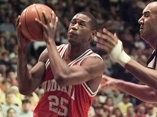 Indiana's A.J. Guyton (25) drives to the basket past Michigan's Brandon Smith in 2000.
