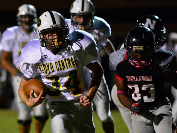 Floyd Central's Gaige Klingsmith (34) runs for a gain. The New Albany Bulldogs host the Floyd Central Highlanders on Friday night. October 18, 2013