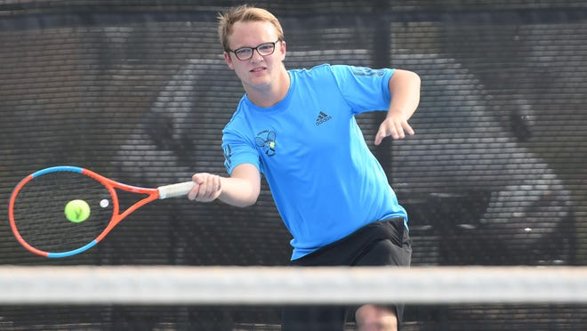 Pueblo West High School senior Christian Kruger hits a forehand during he and his partner Will Dammann's victory at No. 4 doubles against Pueblo County on Aug. 25 at Pueblo West.