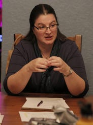 Kelly Matthews, president of Oshkosh Co-Op, meets with