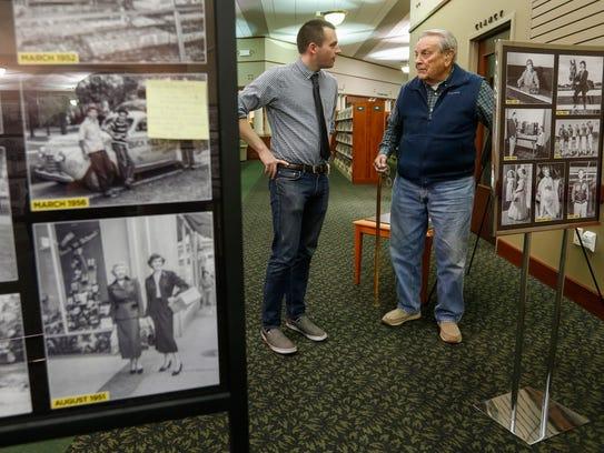 Reporter Stephen Herzog talks with Tom Baker during