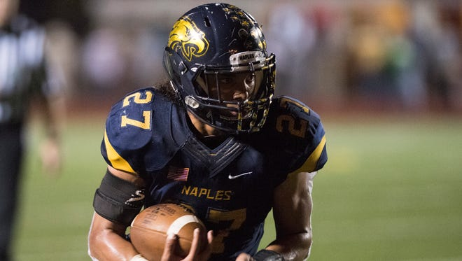 Chez Mellusi of Naples runs for a touchdown during the 6A regional final game against Fort Myers at Naples High Friday night, November 24, 2017.