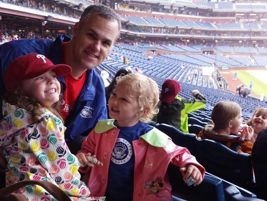From left, Lily, Brad and Jovie Jennings during a terrible, horrible, no good, very bad day at Citizens Bank Park in Philadelphia.