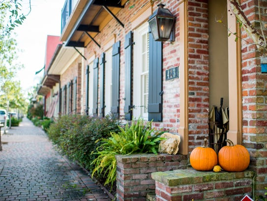 Pumpkins sit at the doorstep of a home in River Ranch
