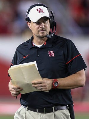 Houston coach Tom Herman on the sideline while his team plays Memphis.
