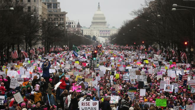 Protesters rally during the Women's March on Washington, with the U.S. Capitol in the background, on January 21, 2017 in Washington, D.C.