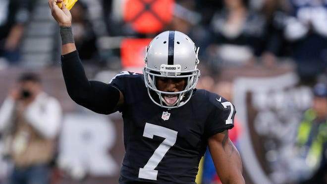 OAKLAND, CA - DECEMBER 04:  Marquette King #7 of the Oakland Raiders dances with a penalty flag after the Buffalo Bills were penalized for roughing the kicker during their NFL game at Oakland Alameda Coliseum on December 4, 2016 in Oakland, California. King recieved an unsportsmanlike conduct penalty for touching the officials flag. (Photo by Brian Bahr/Getty Images)