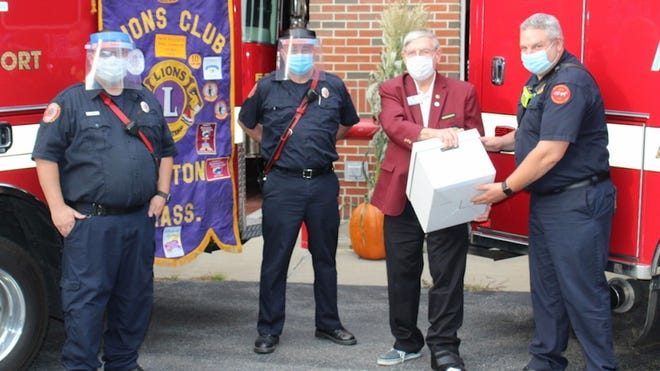 Paxton Lions Club member Bob Wilby, third from left, presents face shields to Paxton first responders. From left are firefighter/paramedics Chris Whynot and Rick McGinn, Wilby and Emergency  Management Director/Assistant Fire Chief Michael Pingitore.