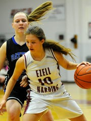 Ezell Harding's Caitlyn Parsons (10) drives past BGA's Ashley Abner (2) during the first half of the girls DII-A Region tournament Tuesday Feb. 10, 2015, in Nashville, Tenn.