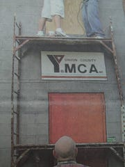Students Travis Duncan and Cody Riggs worked on the YMCA in August 2007 as part of their Senior Carpentry 3 class. Supervising was their instructor, Coach Dennis Walls.