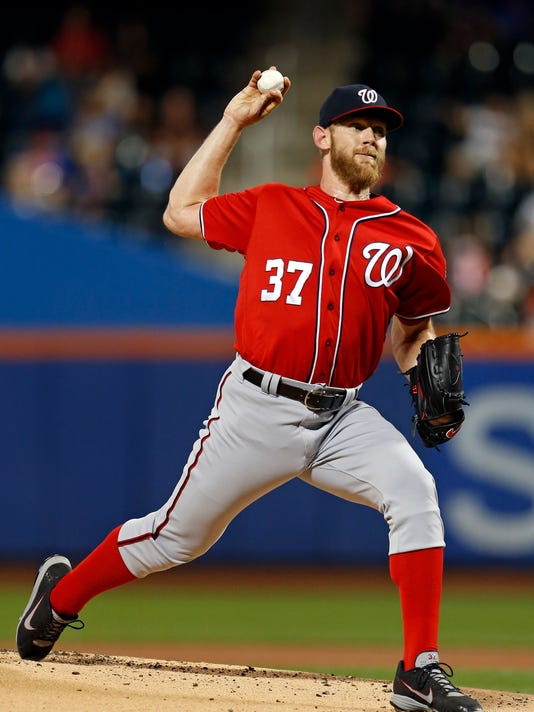 Washington Nationals pitcher Stephen Strasburg throws during the first inning of a baseball game against the New York Mets on Saturday, Sept. 23, 2017, in New York. (AP Photo/Adam Hunger)