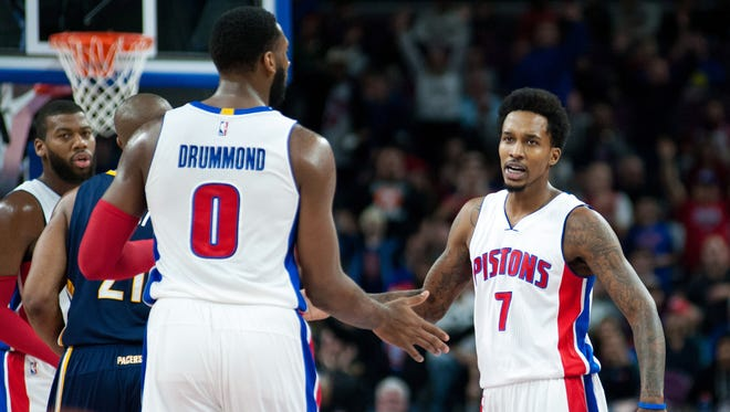 Detroit Pistons guard Brandon Jennings (7) high-fives center Andre Drummond against the Indiana Pacers at the Palace of Auburn Hills.