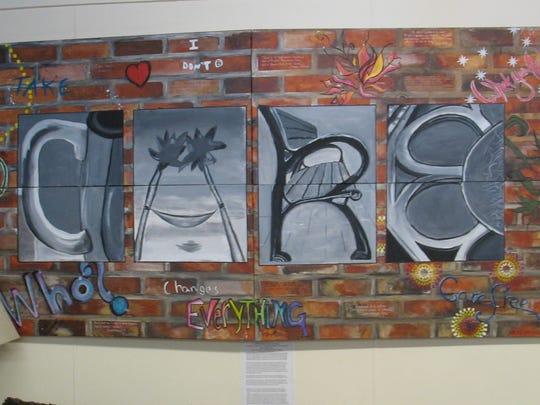 Elizabeth Sharp and three classmates made this mural that now hangs in the Dryden Cafe.