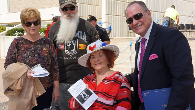Donata Dalesandrio, retired Army Sgt. Milt Langley of Vineland, Millville resident Dotty Cullen and Vineland Mayor Ruben Bermudez appear at the POW/MIA Recognition Day Ceremony outside the city hall building Friday.